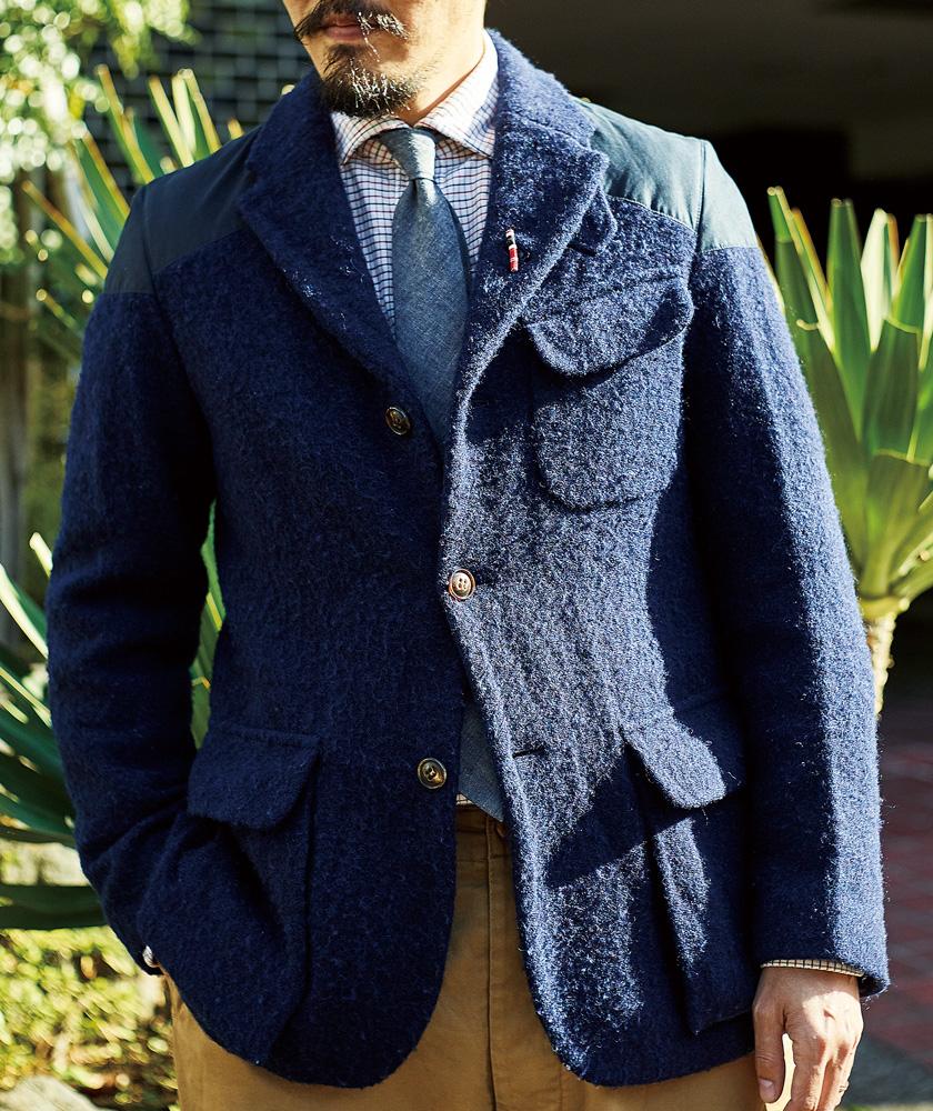 ナイジェル・ケーボンのスタンダードなマロリージャケットを着用するプレス担当の吉田さん